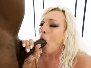 Grandma blows black cock