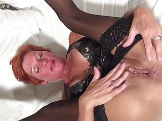 Squirting red mother toying her cunt with banana