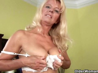 Blond granny in nylons disrobes off and masturbates