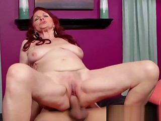Horny redhead granny enjoys big cock in her pussy