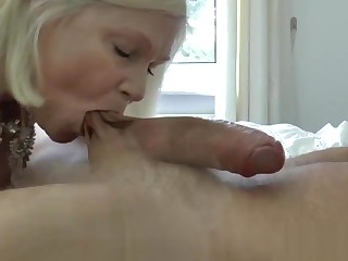 Granny enjoys a big cock in her wet pussy