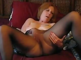 Granny masturbating in pantyhose