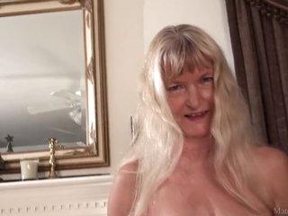 Skinny sexy granny Nancy masturbated with dildo on video