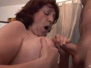 Horny Czech granny with red hair is often using sex toys and having sex with younger guys