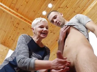 Blonde mature teacher is showing tits during a private class and rubbing her students cock