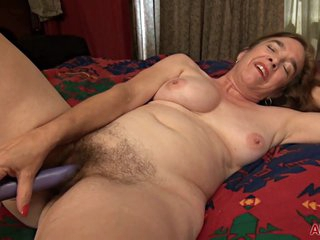 Melody Garner is a mature woman with a hairy pussy who likes to masturbate with a vibrator