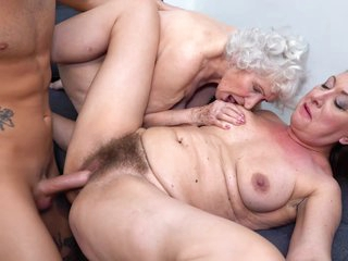 Insatiable, hairy granny is having a casual threesome with a younger couple from the neighborhood